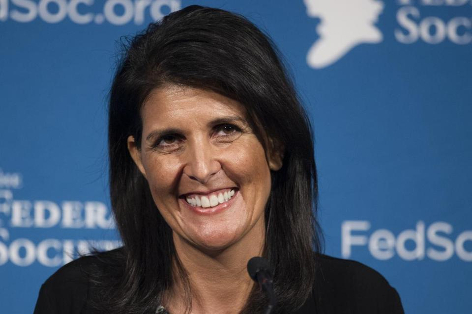 FILE - In this Friday, Nov. 18, 2016 photo, South Carolina Gov. Nikki Haley smiles while speaking at the Federalist Society's National Lawyers Convention in Washington. President-elect Donald Trump has chosen Haley as U.S. ambassador to the United Nations, and he will treat the ambassadorship as a Cabinet-level position, according to two sources familiar with Trump's decision who requested anonymity to discuss the decision and its announcement. Haley, an outspoken Trump critic throughout much of the presidential race, would become his first female - and first nonwhite - Cabinet-level official if confirmed by the Senate. (AP Photo/Cliff Owen, File)