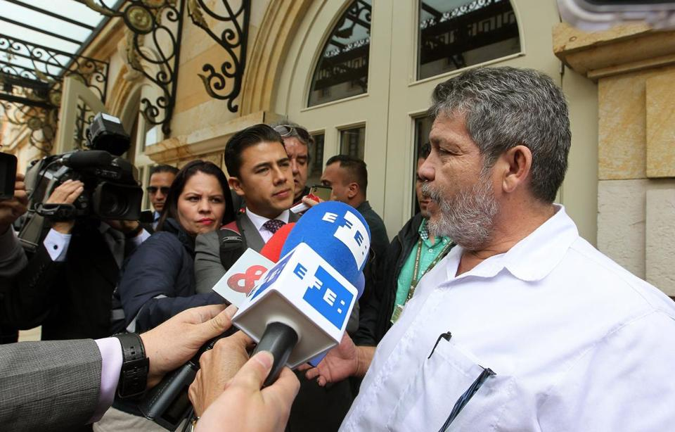 FARC leader Luis Alberto Alban spoke to media members outside the Teatro Colon in Bogota, Colombia, on Wednesday.