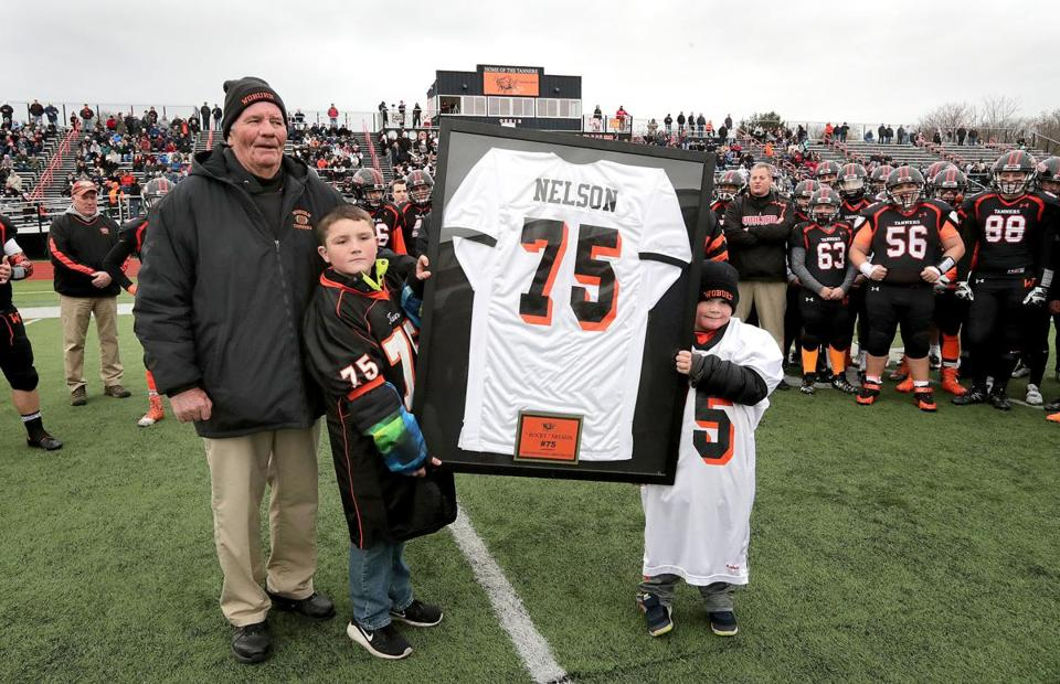 Rocky Nelson with his grandsons Dylan Sigsbury (left) and Quinn Boyd during pregame a pregame ceremony.