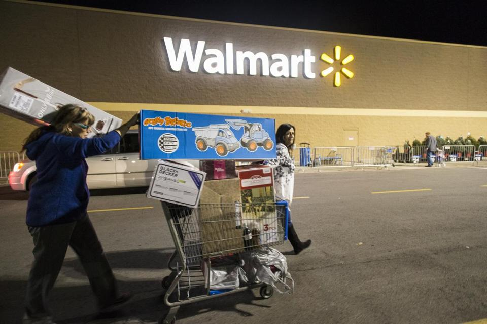 Holiday shoppers left a Black Friday event at Walmart's Bentonville, Ark., store in 2016.