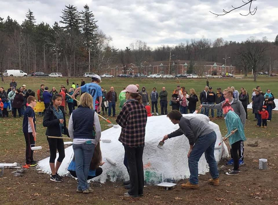 Bromfield High School students painted a rock on school grounds that had been defaced with hate speech.