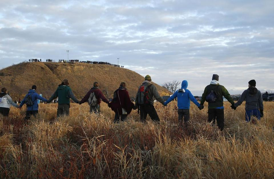 In November, protesters joined hands as police lined the hill at Standing Rock.