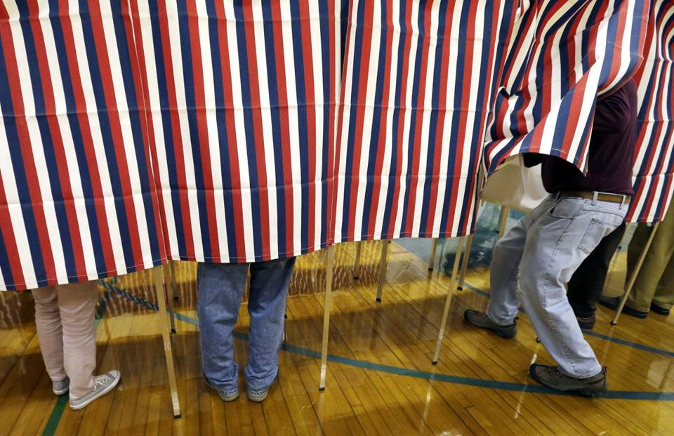 A voter entered a booth at a polling place in Exeter, N.H.