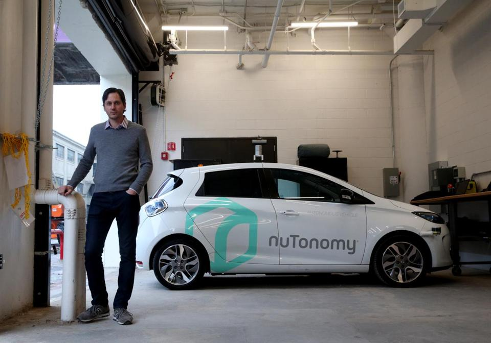 Karl Iagnemma co-founder of nuTonomy posed for a portrait with a self-driving car in Boston.