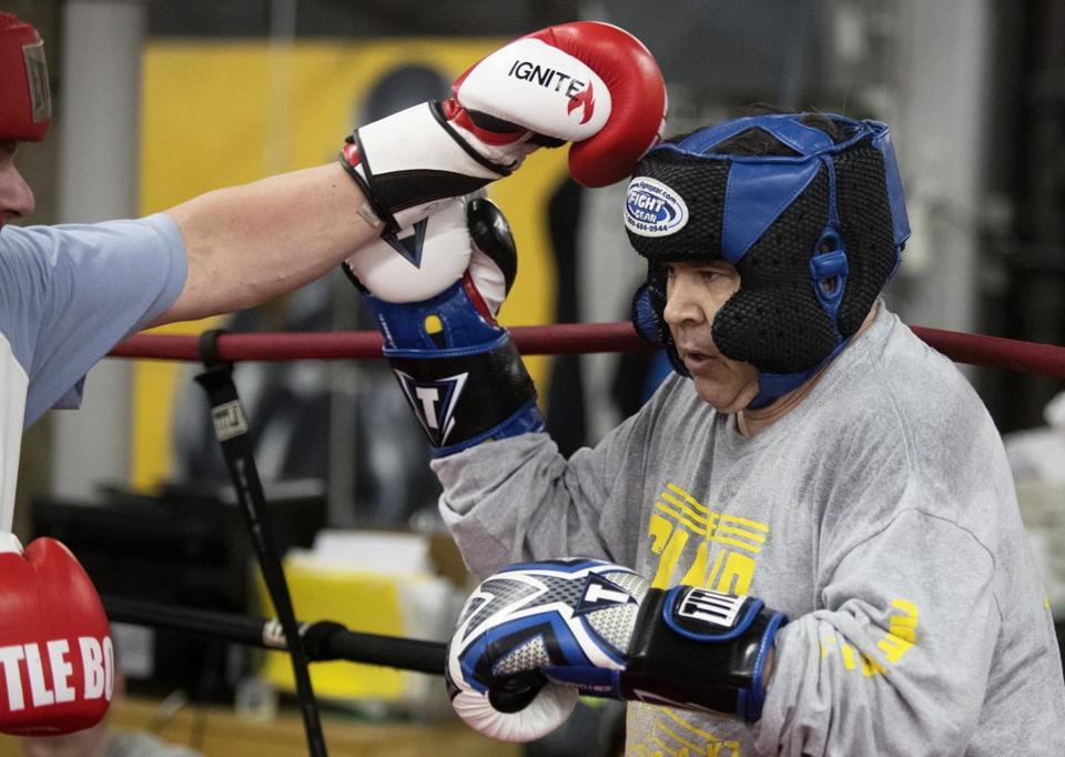 "Boston, Ma-November 12, 2016- Stan Grossfeld/Globe Staff- Sean McCarthy, a boxer with cerebral palsy, during a ""special bout"" during fight night at The Ring Boxing Club."