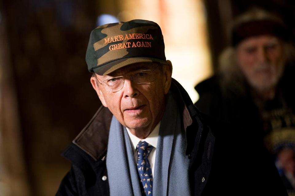 NEW YORK, NY - NOVEMBER 29: Wilbur Ross, President-elect Donald Trump's choice for Commerce Secretary, wears a 'Make America Great Again Hat' as he speaks briefly to reporters at Trump Tower, November 29, 2016 in New York City. President-elect Donald Trump and his transition team are in the process of filling cabinet and other high level positions for the new administration. (Photo by Drew Angerer/Getty Images)