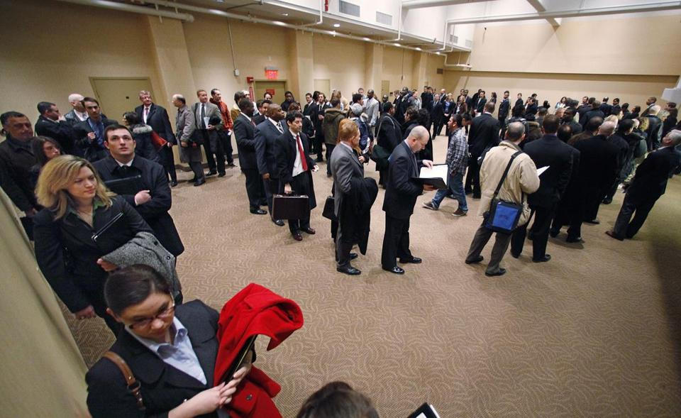 Hundreds of prospective employees cue up in a serpentine line during a National job fair at a hotel in Boston, Monday, March 23, 2009. The government said Thursday, March 26, initial jobless benefit claims rose slightly last week while the number of people continuing to claim benefits set a record for the ninth straight week. (AP Photo/Stephan Savoia)
