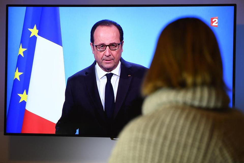 A person watched as French President Francois Hollande made a televised statement on Thursday to announce that he would not run for a second term.