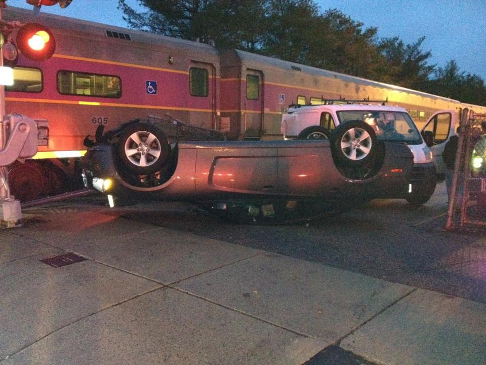 Commuter rail train struck car that was parked near the tracks at Needham Heights stop per fire officials. No injuries.