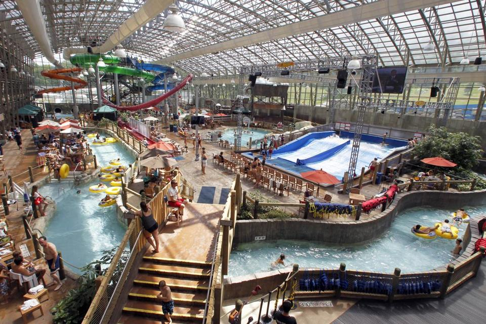 In this Aug. 8, 2012 photo, people enjoy the Jay Peak Pump House indoor waterpark in Jay, Vt. Guests at Northern New England ski resorts are still enjoying waterparks and zip lines, but after a dismal, snowless winter, owners are looking ahead and trying to lock in skiers to season passes for the coming season. (AP Photo/Toby Talbot)
