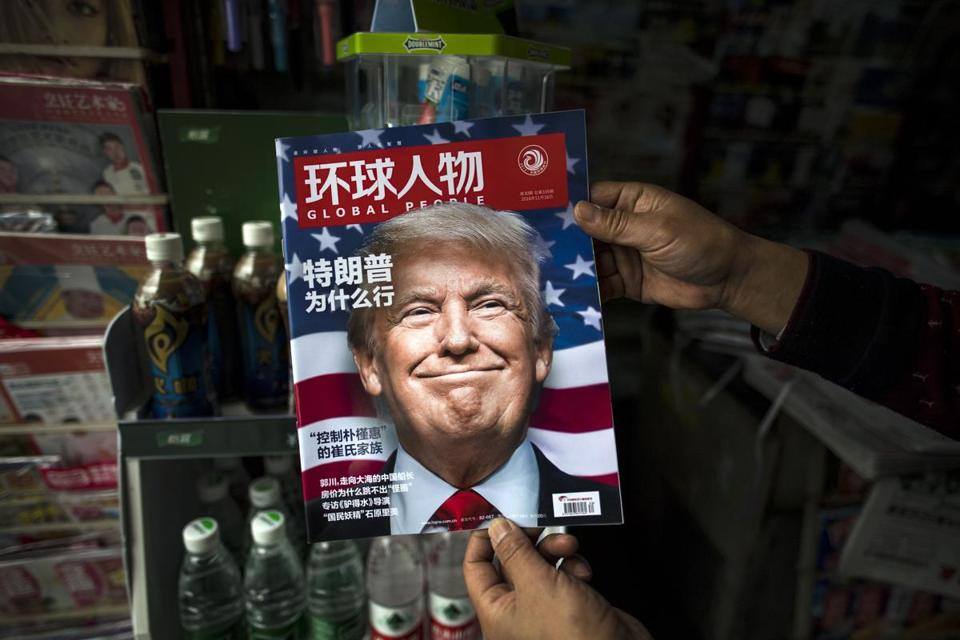 "This file photo taken on Nov. 14, 2016, shows a copy of the local Chinese magazine Global People with a cover story that translates to ""Why did Trump win"" at a newsstand in Shanghai."