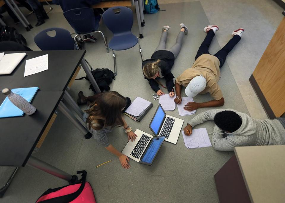 NATICK MA - 12/02/2016:Freshman students in a physics class work on the floor of the classroom as if in a home study group atmosphere at Natick High School. International PISA test results released, Natick HS is among the Massachusetts schools that took the international test and has used previous results to effectively boost its instruction in math, science and literacy -- making the school among the best in the world. (David L Ryan/Globe Staff Photo) SECTION: METRO TOPIC 06pisa