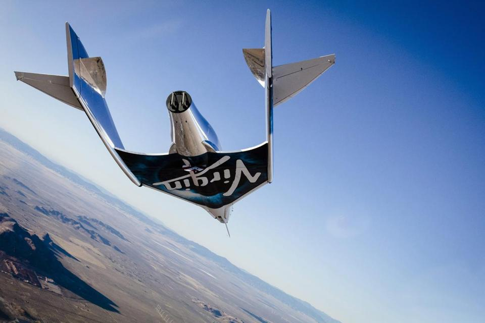 epa05660110 A handout image released by Virgin Galactic on 04 December 2016 shows Virgin Spaceship Unity (VSS Unity) glides for the first time after being released from Virgin Mothership Eve (VMS Eve) over the Mojave Desert, USA, 03 December 2016. The VSS Unity sucessfully landed after a free-flying test at Mojave Desert, some two years after a man died when the spaceship's predecessor crashed. EPA/VIRGIN GALACTIC / HANDOUT HANDOUT EDITORIAL USE ONLY/NO SALES
