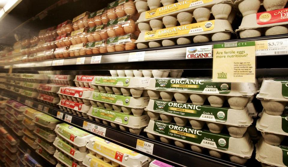 Organic eggs on the shelves 05 January 2006 at the Whole Foods Market in Willowbrook, Illinois. Whole Foods Market along with other organic food distributors are trying to bring down the cost of organic foods to attract the family on a budget. (Photo credit should read JEFF HAYNES/AFP/Getty Images)