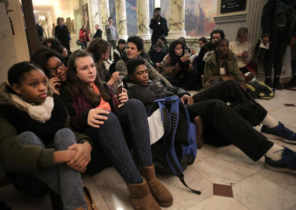 Boston, MA - 12/05/16 - Protesters wait unsuccessfully to see Governor Charlie Baker outside his office. Protesters, including some who walked out of local high school and college classes, brought concerns over the past election cycle to a rally on Boston Common, outside the State House, and then to the office of Governor Charlie Baker. (Lane Turner/Globe Staff) Reporter: () Topic: (06walkout)