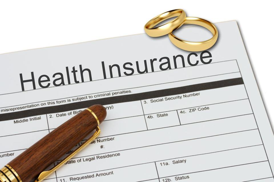 Applying for a Health Insurance, Health Insurance application form with a pen on a desk