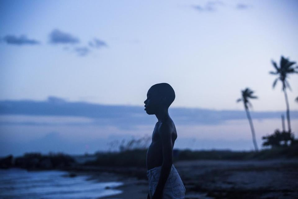 "This image released by A24 Films shows Alex Hibbert in a scene from the film, ""Moonlight."" In Hollywood's early but rapidly solidifying awards season, two films -- radically different in tone and tune -- have separated themselves from the pack: ""Moonlight"" and ""La La Land."" ""Moonlight,"" Barry Jenkins' lyrical coming-of-age tale, added to its already hefty haul on Sunday, taking best picture from the Los Angeles Film Critics Association. (David Bornfriend/A24 via AP)"