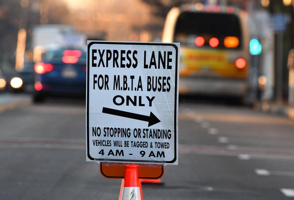 An MBTA bus drove on a dedicated lane converted from parking spaces on one side of Broadway in Everett during a one-week trial in December 2016.