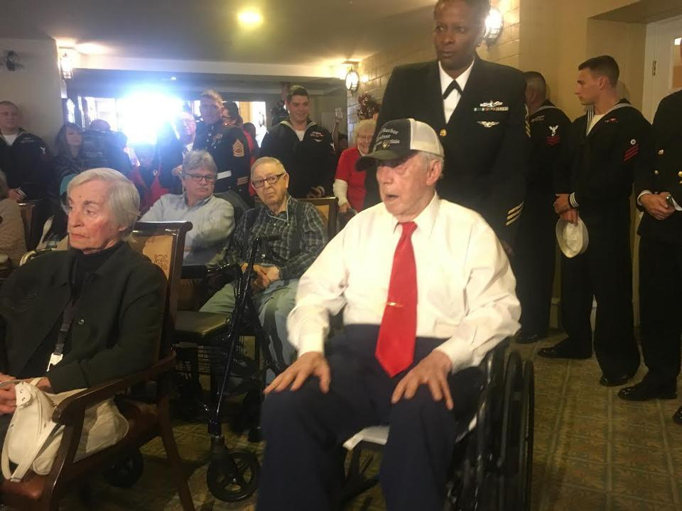 Bill Keith enters the room at the beginning of a ceremony honoring his survival of the Pearl Harbor attack.