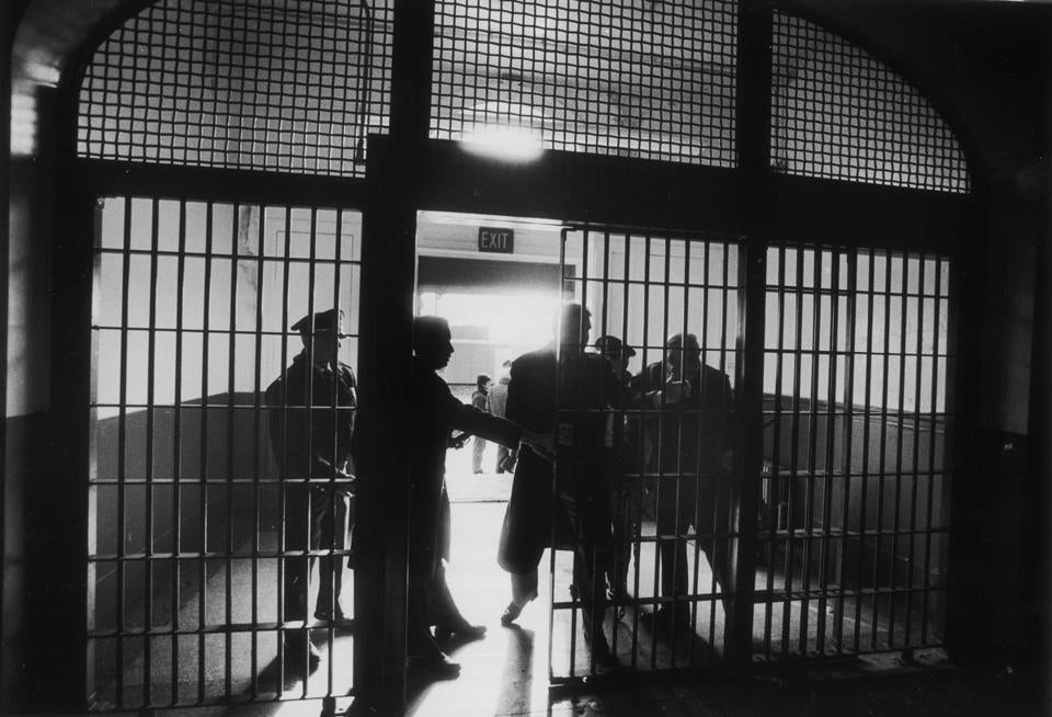 OPS PHOTO BY david l ryan bw december 30 1991 deerisland boston harbor islands- 19th century house of correction deer island. suffolk county sheriff robert rufo decommission jail closing the front door.