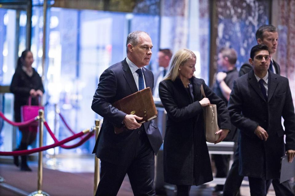 epa05664052 Oklahoma Attorney General Scott Pruitt (L) arrives at Trump Tower in Manhattan, New York, USA, 07 December 2016. US President-elect Donald Trump is holding meetings at Trump Tower as he continues to fill in key positions in his new administration. EPA/JOHN TAGGART / POOL
