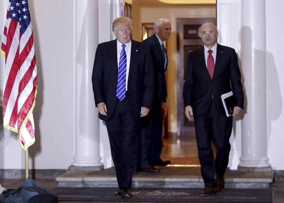 President-elect Donald Trump and Andy Puzder, chief executive of CKE Restaurants, walk from Trump National Golf Club Bedminster clubhouse in Bedminster, N.J., Saturday, Nov. 19, 2016. In the background is Vice President-elect Mike Pence. (AP Photo/Carolyn Kaster)