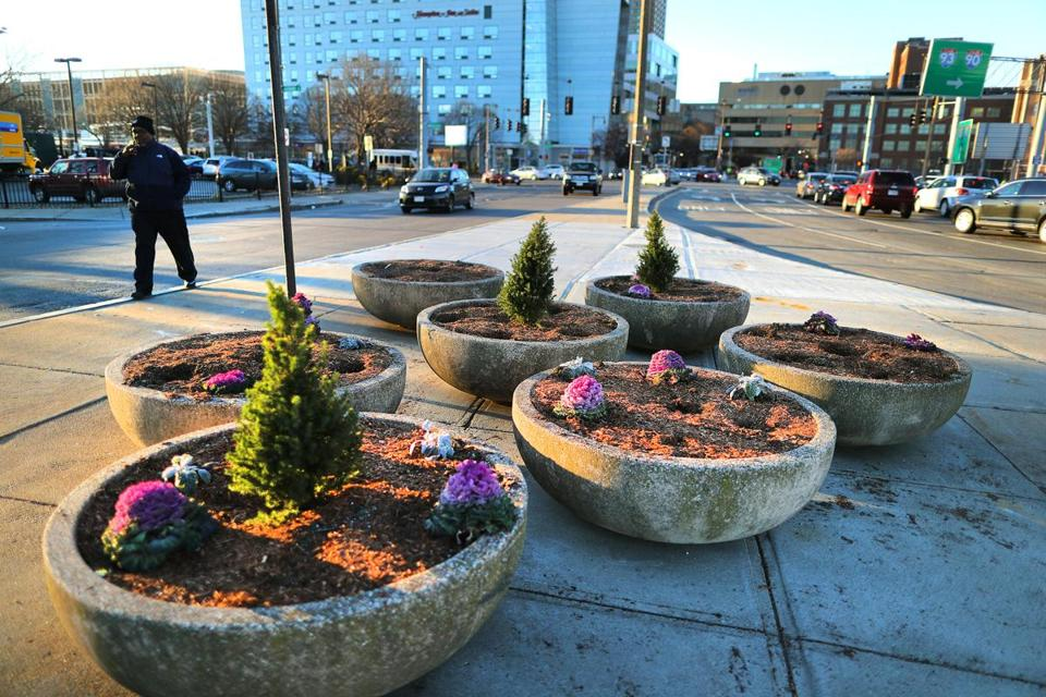 Planters on Massachusetts Avenue are part of an effort to clean up and beautify that street and Melnea Cass Boulevard.