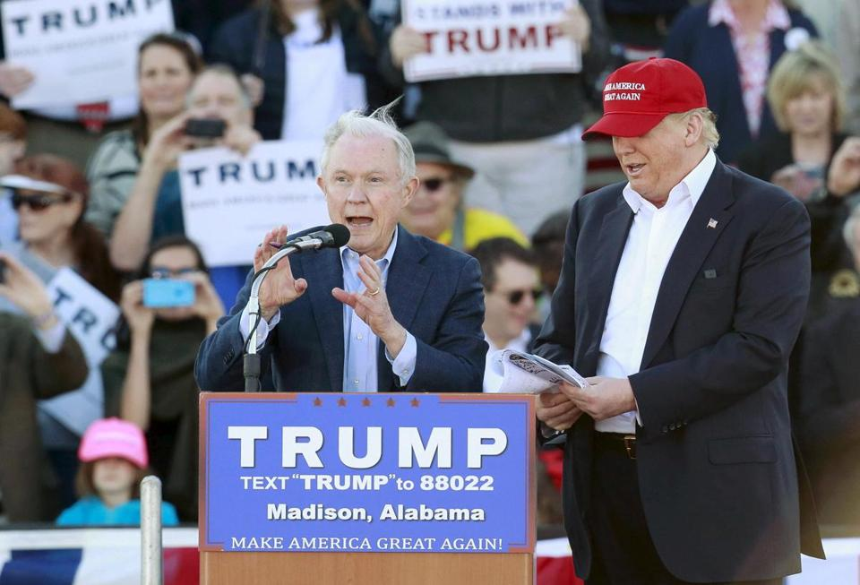 U.S. Senator Jeff Sessions speaks next to U.S. Republican presidential candidate Donald Trump at a rally at Madison City Schools Stadium in Madison, Alabama February 28, 2016. REUTERS/Marvin Gentry/File Photo