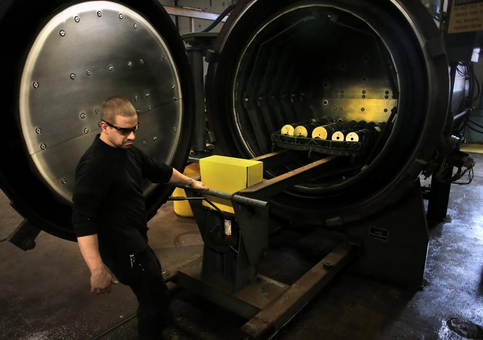 Brendan Geldart loaded a rack of circular blades into an oven that heat treats them at the Hyde Group's factory in Southbridge.
