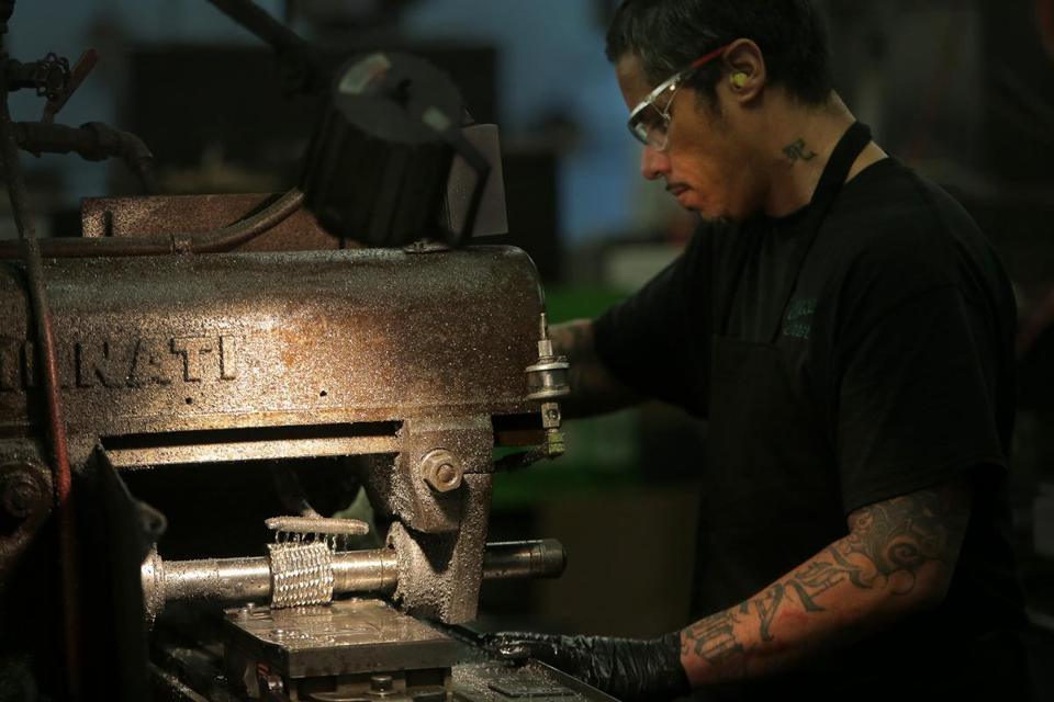 Jose Andujar worked with a milling machine at the Hyde Group's factory in Southbridge.