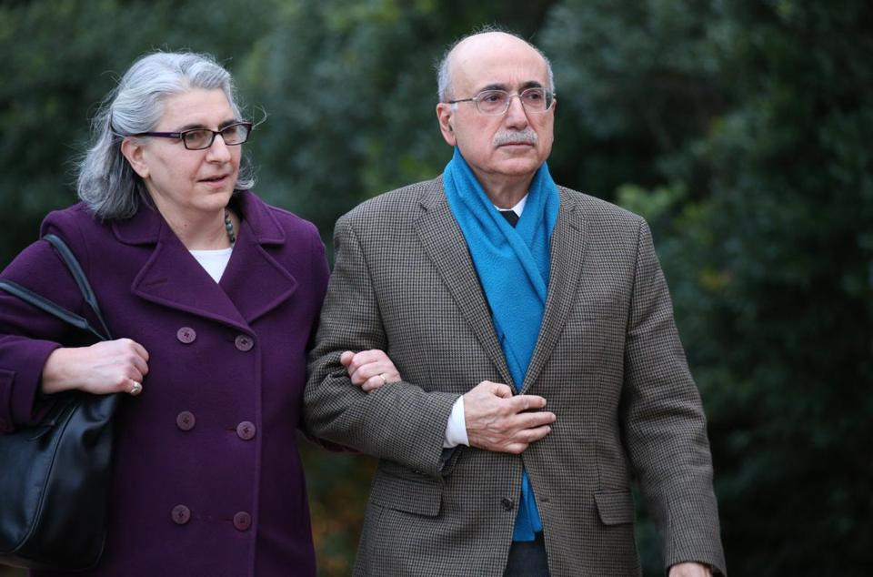 Edward J. Tutunjian, shown with his wife, Nancy, in December, will sell his taxi medallions and several properties in the Fenway to developer Jay Doherty.
