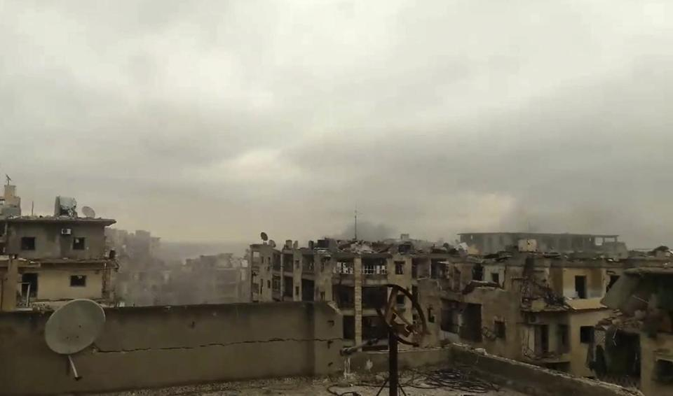 Smoke rose in the distance during heavy bombardment in east Aleppo Wednesday.
