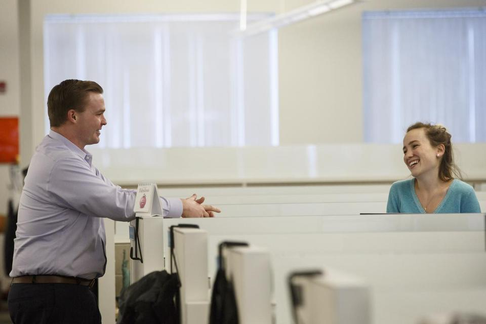Jane Alexander and Brian Porrell work in offices of Winter Wyman in Waltham, MA on December 15, 2016. Millennials, such as Porrell and Alexander, are bigger workaholics than any other generation in the workforce and are happy to be seen that way, according to a new study. (Keith Bedford/Globe Staff) Topic: Reporter: