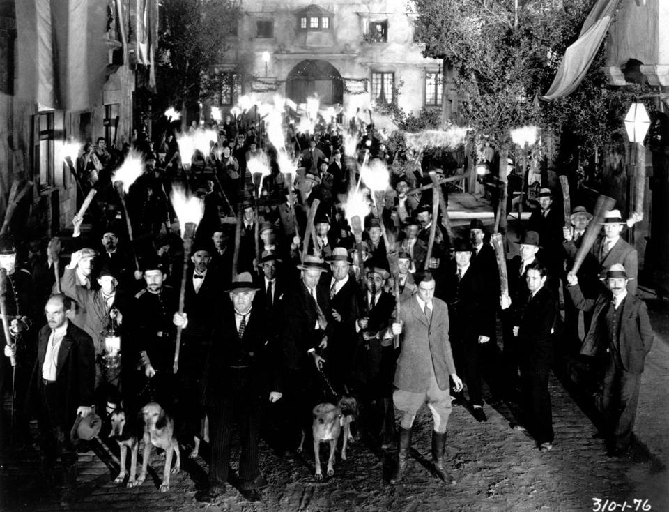 An angry mob holding torches in a still from the film, 'Frankenstein,' directed by James Whale, 1931. (Photo by Getty Images)