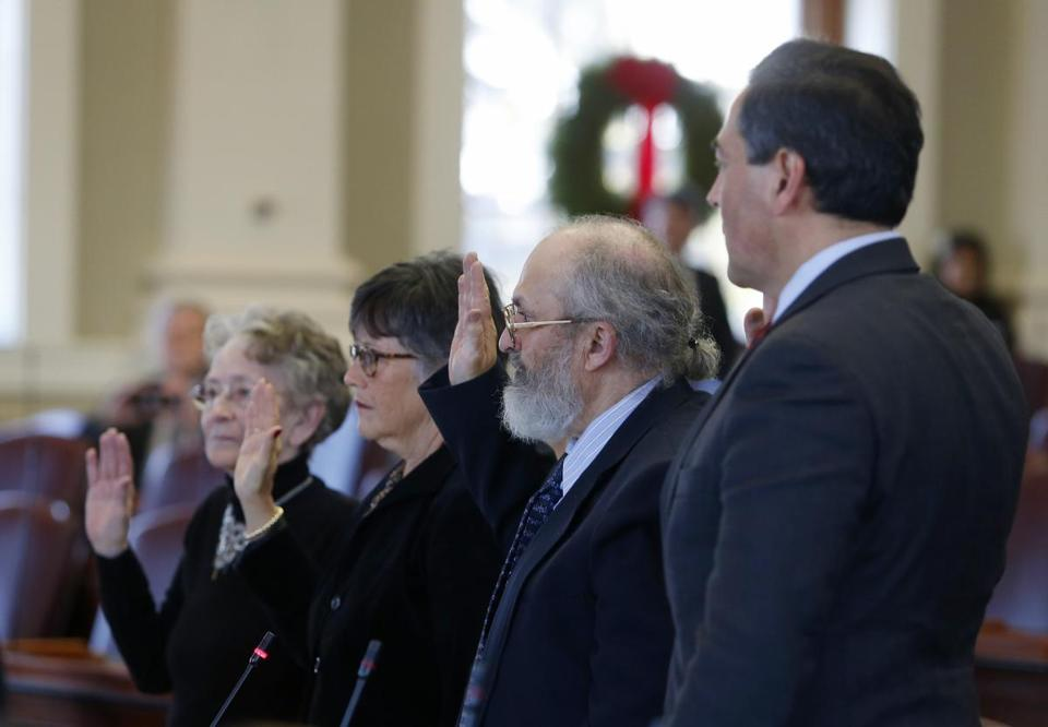 Augusta, ME -- 12/19/2016 - Electors Betty Johnson, Diane Denk, David Bright and Rick Bennett are sworn in as electors at the State House in Augusta, Maine. (Jessica Rinaldi/Globe Staff) Topic: Reporter: