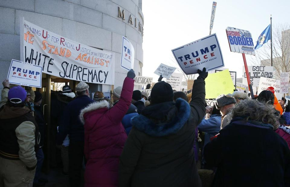 Augusta, ME -- 12/19/2016 - Republicans marching to escort elector Rick Bennett are met with opposition outside of the State House in Augusta, Maine. (Jessica Rinaldi/Globe Staff) Topic: Reporter: