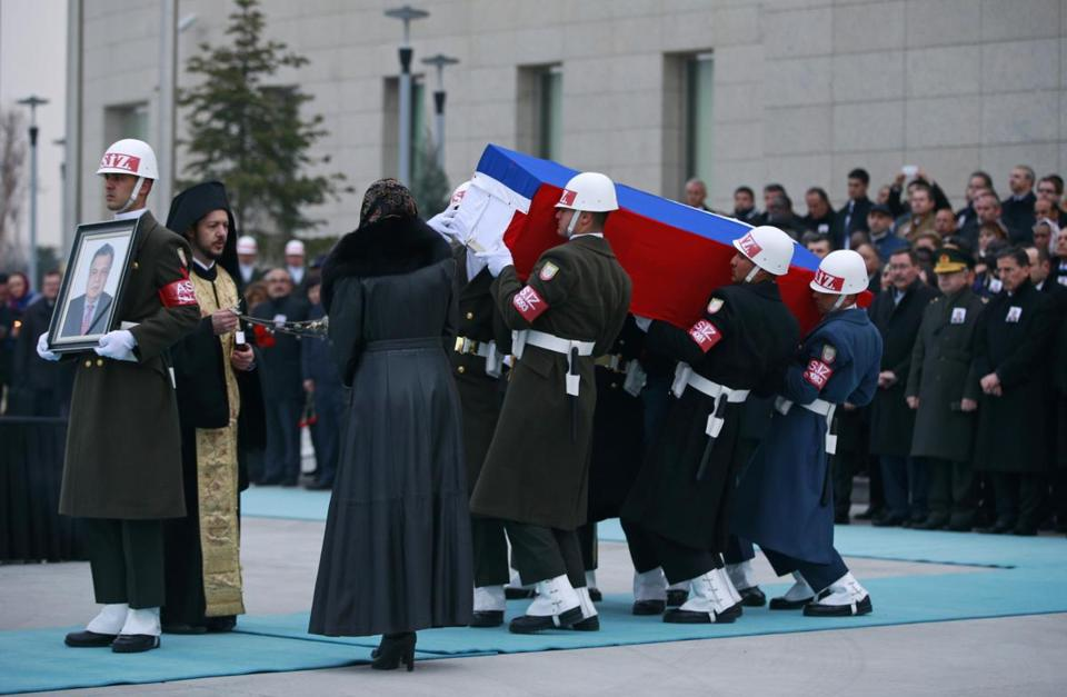 Members of a Turkish forces honor guard carry the coffin of Andrei Karlov, the Russian ambassador to Turkey, during a ceremony at the airport in Ankara on Tuesday.