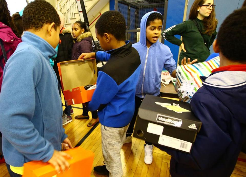 Children enjoy showing off their gifts to each other during the annual St. Peter's Teen Center annual Christmas Eve Party, located at 278 Bowdoin St., Dorchester. Mark Lorenz for the Boston Globe