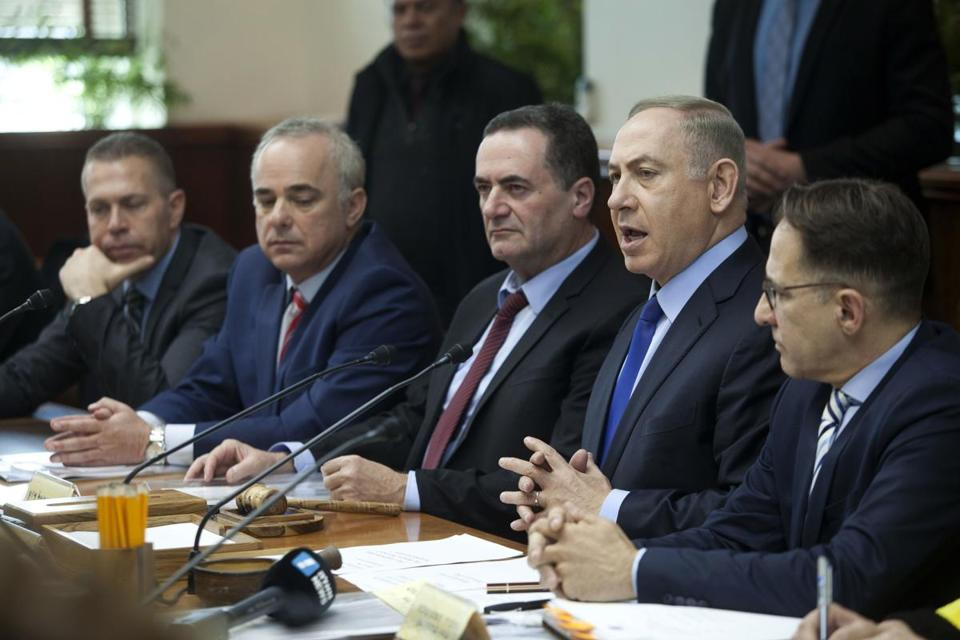 Israeli Prime Minister Benjamin Netanyahu, second right, attends a weekly cabinet meeting in Jerusalem, Sunday, Dec. 25, 2016. (Dan Balilty/Pool photo via AP)