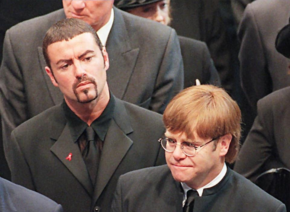 (FILES): This file photo taken on September 6, 1997 shows pop stars George Michael (L) and Elton John (R) leaving Westminster Abbey following the funeral service of Diana, Princess of Wales. British pop singer George Michael, who rose to fame with the band Wham! and sold more than 100 million albums in his career, has died aged 53, his publicist said on Sunday, December 25, 2016. / AFP PHOTO / AFP POOL / JOHNNY EGGITTJOHNNY EGGITT/AFP/Getty Images