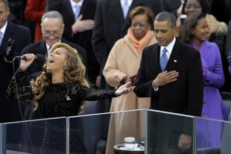 "FILE - This Jan. 21, 2013 file photo shows President Barack Obama, right, as Beyonce sings the National Anthem at the ceremonial swearing-in at the U.S. Capitol during the 57th Presidential Inauguration in Washington. On Wednesday, President-elect Donald Trump picked ""America's Got Talent"" star Jackie Evancho to sing the national anthem at his inauguration. (AP Photo/Carolyn Kaster, File)"
