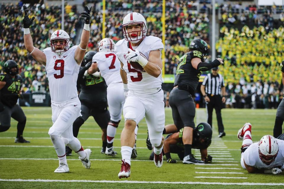 "FILE - In this Nov. 12, 2016, file photo, Stanford running back Christian McCaffrey (5) runs for a touchdown in the first quarter of an NCAA college football game, in Eugene, Ore. McCaffrey is done playing college football. Stanford's star running back announced on Twitter on Monday, Dec. 19, 2016, that he will not play in the 16th-ranked Cardinal's Sun Bowl game against North Carolina (8-4) on Dec. 30 in El Paso, Texas. ""Very tough decision, but I have decided not to play in the Sun Bowl so I can begin my draft prep immediately,"" McCaffrey said. (AP Photo/Thomas Boyd, File)"