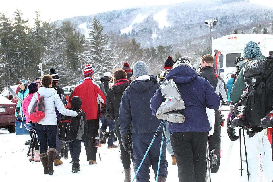 People waited in line for shuttles that took them to Wachusett's slopes Friday.