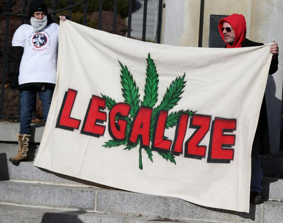 Marijuana supporters stood outside the State House on Dec. 30.