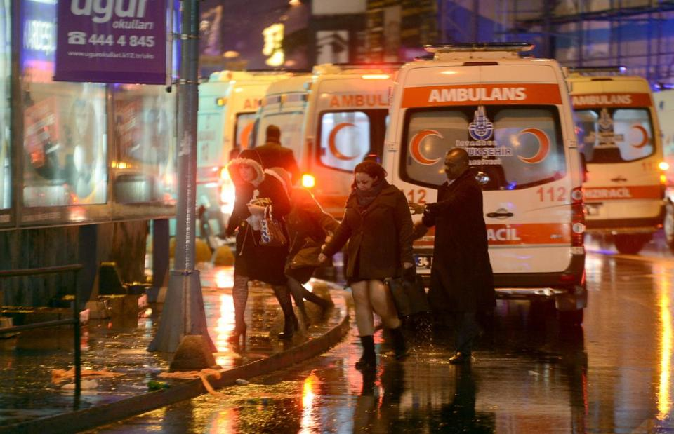 People flee as ambulances are on the attack site on January 1, 2017 in Istanbul. At least two people were killed in an armed attack Saturday on an Istanbul nightclub where people were celebrating the New Year, Turkish television reports said. / AFP PHOTO / IHLAS NEWS AGENCY / IHLAS NEWS AGENCYIHLAS NEWS AGENCY/AFP/Getty Images