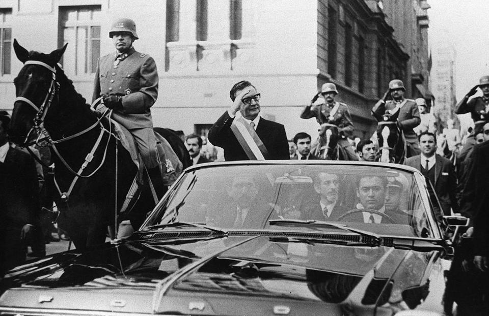 Chilean President Salvador Allende waved to supporters in Santiago a few days after his election in 1970. The car was escorted by General Augusto Pinochet.
