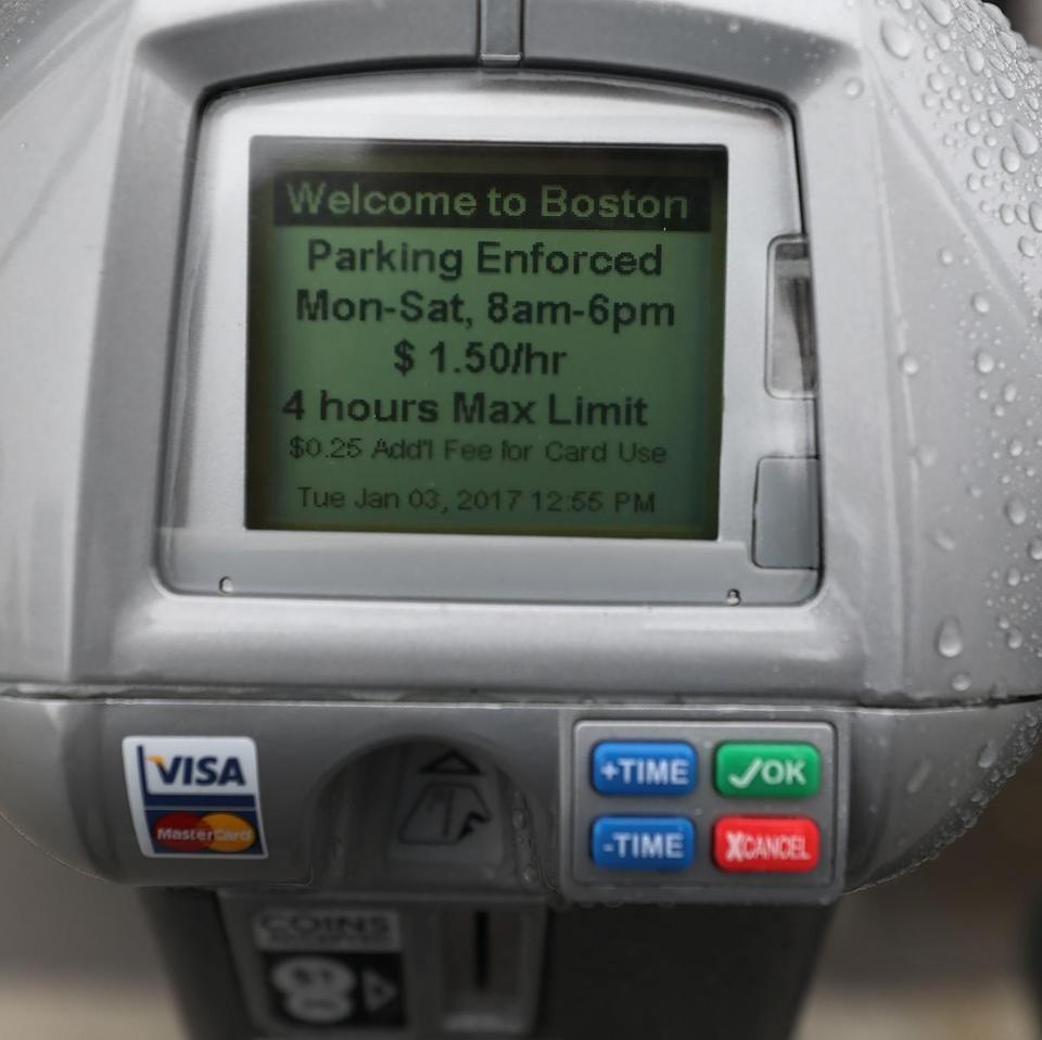 BOSTON, MA - 1/03/2017:A close up of meter rates on Seaport Blvd.... In Boston the new pilot parking rates on meters goes into effect in Back Bay and Seaport areas (David L Ryan/Globe Staff Photo) SECTION: METRO TOPIC 04parking
