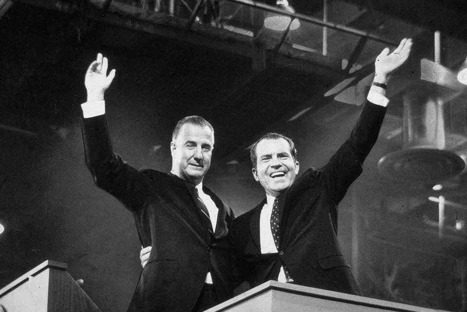 Republican presidential candidate Richard M. Nixon (R) and his running mate Spiro Agnew wave to crowds during the campaign, circa 1968. (Photo by Hulton Archive/Getty Images)