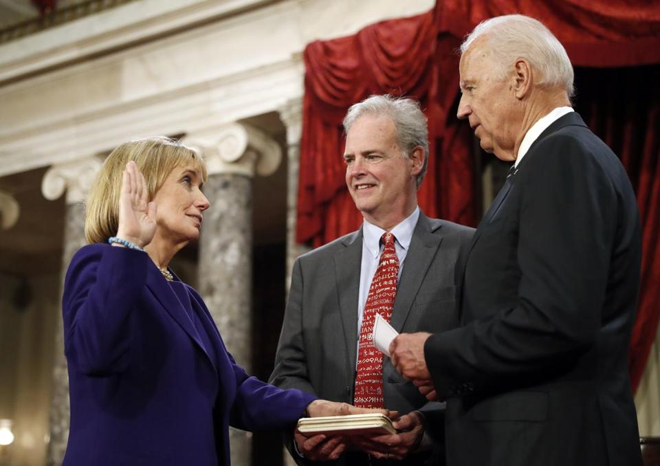 Vice President Joe Biden, right, administers the Senate oath of office to Sen. Maggie Hassan, D-N.H., as her husband Thomas Hassan holds a bible, during a mock swearing in ceremony in the Old Senate Chamber on Capitol Hill in Washington, Tuesday, Jan. 3, 2017, as the 115th Congress begins. (AP Photo/Alex Brandon)