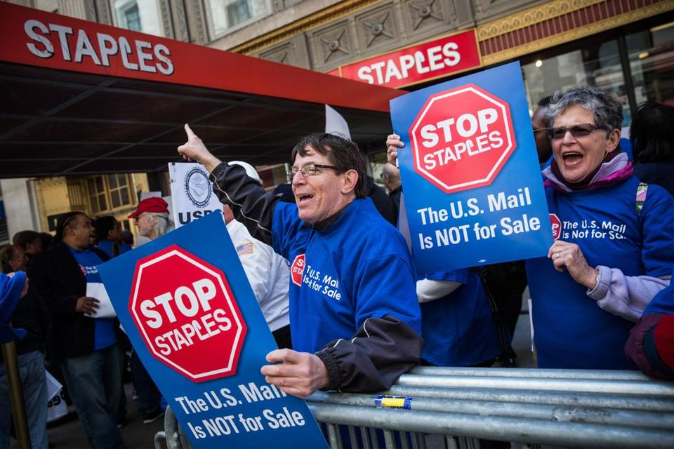 Unionized Postal Service workers protested outside a Staples store in April 2014.